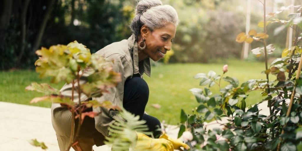A black women gardens in retirement.